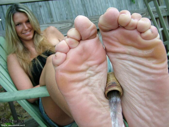 Feet of women, feet of girls, barefoot girls, women without shoes, soles of women's feet